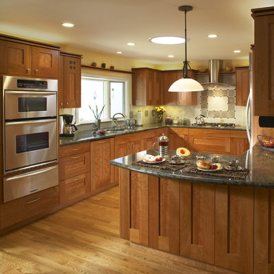 Elegant u-shaped kitchen photo in San Francisco with stainless steel appliances, a double-bowl sink, shaker cabinets, medium tone wood cabinets and granite countertops