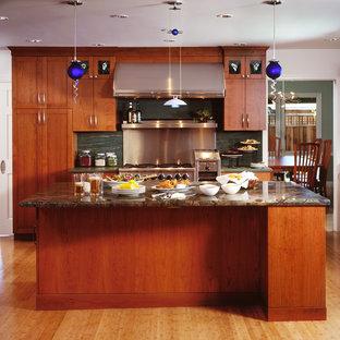 Kitchen - contemporary kitchen idea in San Francisco with medium tone wood cabinets, green backsplash, stone slab backsplash and stainless steel appliances