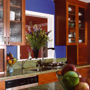 Photo of a traditional kitchen in San Francisco with glass-front cabinets, dark wood cabinets and recycled glass benchtops.