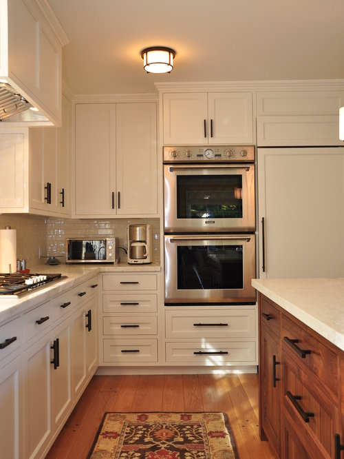 kitchen idea in san francisco with paneled appliances cabinets white