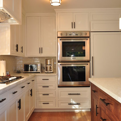 Kitchen - contemporary kitchen idea in San Francisco with paneled appliances, recessed-panel cabinets, white cabinets, marble countertops, white backsplash and subway tile backsplash