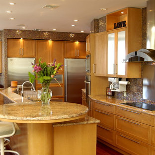 Large contemporary kitchen photos - Inspiration for a large contemporary l-shaped brown floor and dark wood floor kitchen remodel in New York with stainless steel appliances, light wood cabinets, an undermount sink, shaker cabinets, granite countertops, mosaic tile backsplash, an island and multicolored countertops