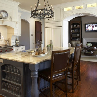 Inspiration for a timeless kitchen remodel in Minneapolis with recessed-panel cabinets, white cabinets, white backsplash and paneled appliances