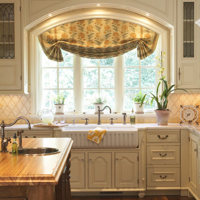 Inspiration for a timeless kitchen remodel in Minneapolis with a farmhouse sink and wood countertops