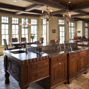 Elegant open concept kitchen photo in Minneapolis with raised-panel cabinets and dark wood cabinets