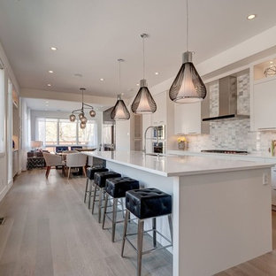 Inspiration for a mid-sized transitional eat-in kitchen in DC Metro with a drop-in sink, cement tile splashback, white appliances, medium hardwood floors and beige floor.