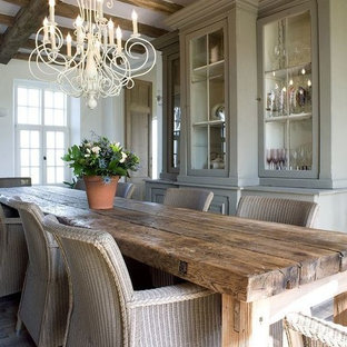 Rustic kitchen inspiration - Example of a mountain style medium tone wood floor and gray floor kitchen design in Other with raised-panel cabinets