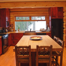 Rustic Kitchen by Traditional Log Homes Ltd