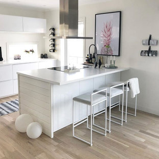Small contemporary eat-in kitchen designs - Inspiration for a small contemporary galley laminate floor eat-in kitchen remodel in Sydney with a single-bowl sink, open cabinets, white cabinets, quartzite countertops, white backsplash, window backsplash, stainless steel appliances, an island and white countertops