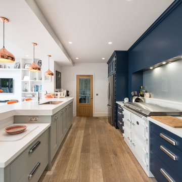 Kitchen in navy, white and grey with orange and copper accents