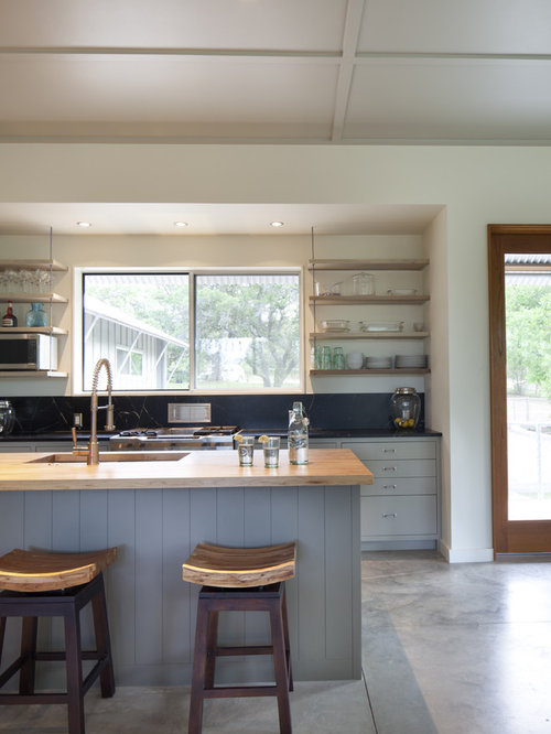 Modern Kitchen Idea In Austin With Wood Countertops And Gray Cabinets