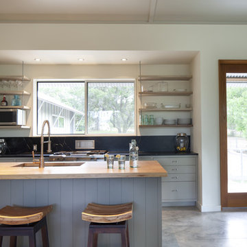 kitchen island with suspended shelves