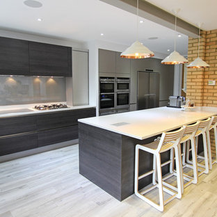 Design ideas for a large modern kitchen in London with dark wood cabinets and an island.