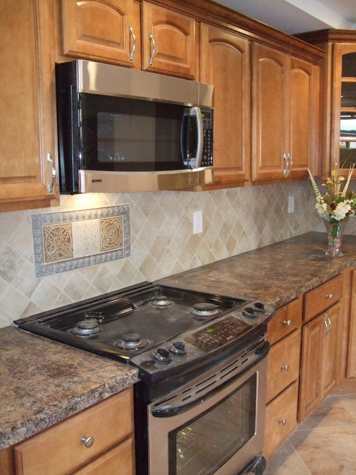 steel appliances laminate countertops an island and a drop in sink