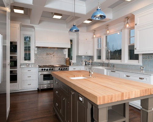 Example of a classic kitchen design in Portland with shaker cabinets,  stainless steel appliances,