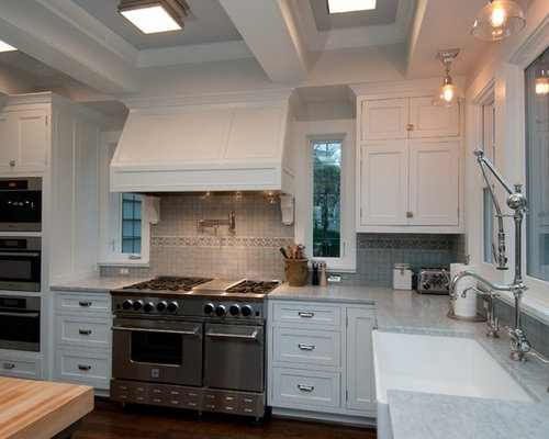 Windows flanking stove home design ideas pictures remodel and decor