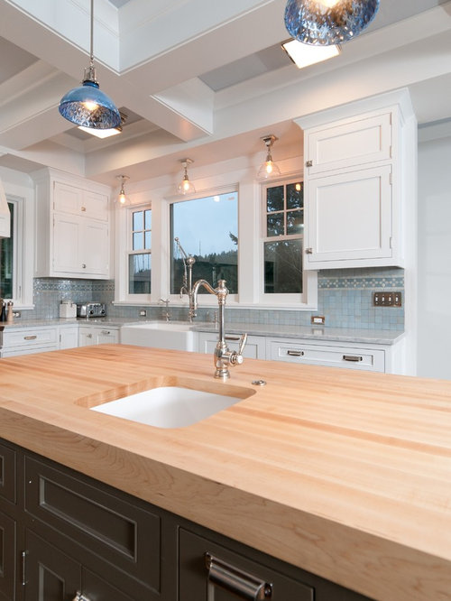 elegant kitchen photo in portland with an undermount sink wood countertops recessed panel - Kitchen Lights Above Sink
