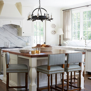 Inspiration for a timeless dark wood floor and brown floor kitchen remodel in Atlanta with shaker cabinets, white cabinets, multicolored backsplash, stone slab backsplash, an island and multicolored countertops