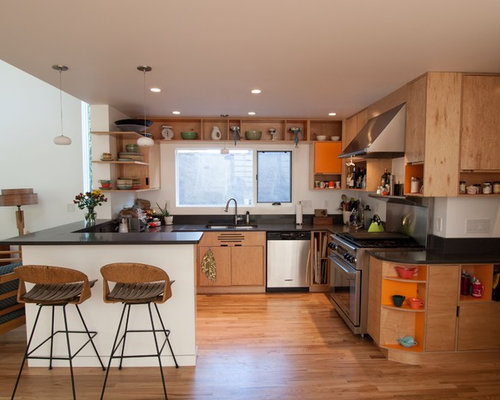 Example Of A Minimalist Kitchen Design In Portland With Stainless Steel  Appliances, Open Cabinets And