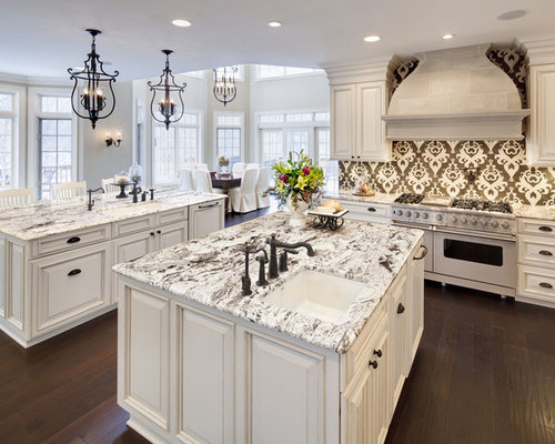 Traditional Eat In Kitchen Idea In Chicago With White Appliances, Granite  Countertops, Raised