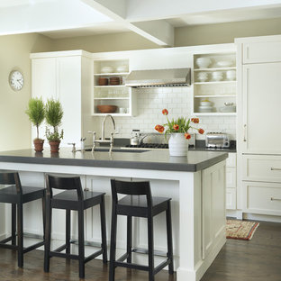 This is an example of a traditional galley kitchen in Providence with open cabinets, white cabinets, white splashback, subway tile splashback, panelled appliances and quartz benchtops.