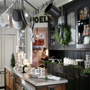 Inspiration for a timeless l-shaped painted wood floor enclosed kitchen remodel in Chicago with distressed cabinets, an island, black backsplash and stainless steel appliances