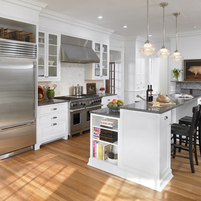 Elegant kitchen photo in Philadelphia with glass-front cabinets and stainless steel appliances