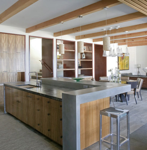 Open Kitchen With Bar Counter Seating And Chefs At Work: Raised Island