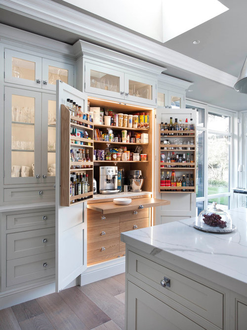 Traditional kitchen pantry remodeling - Traditional light wood floor  kitchen pantry idea in Dublin with flat