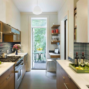 Modern enclosed kitchen ideas - Minimalist galley enclosed kitchen photo in New York with glass tile backsplash, marble countertops, blue backsplash, flat-panel cabinets and medium tone wood cabinets