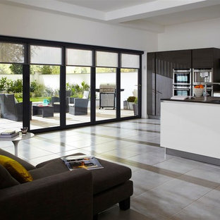This is an example of a large modern open plan kitchen in London with an island.
