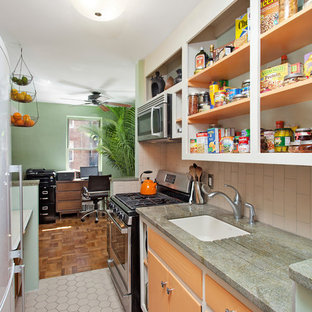Design ideas for a small eclectic galley kitchen in New York with an undermount sink, open cabinets, orange cabinets, quartzite benchtops, beige splashback, porcelain splashback, stainless steel appliances, porcelain floors and beige floor.