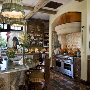 Inspiration for a rustic terra-cotta floor kitchen remodel in Minneapolis with stainless steel appliances and granite countertops