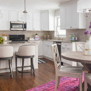 Inspiration for a mid-sized contemporary u-shaped medium tone wood floor and brown floor open concept kitchen remodel in Minneapolis with an undermount sink, shaker cabinets, white cabinets, granite countertops, beige backsplash, subway tile backsplash, stainless steel appliances and an island