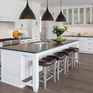 Kitchen - contemporary l-shaped dark wood floor kitchen idea in Minneapolis with an undermount sink, shaker cabinets, white cabinets, white backsplash, paneled appliances and an island