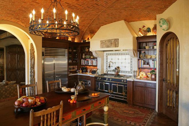 Mediterranean Kitchen by Merlin Contracting & Developing, llc