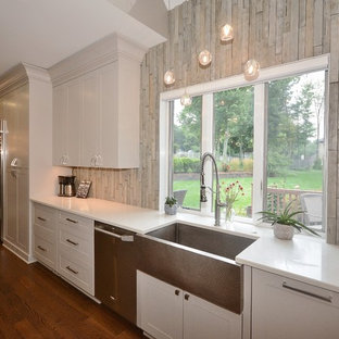 Inspiration for a large transitional u-shaped eat-in kitchen in Other with a farmhouse sink, recessed-panel cabinets, white cabinets, limestone benchtops, beige splashback, porcelain splashback, stainless steel appliances, dark hardwood floors, with island, brown floor and grey benchtop.