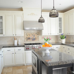 Traditional kitchen pictures - Inspiration for a timeless kitchen remodel in San Diego with white cabinets, beige backsplash and stainless steel appliances