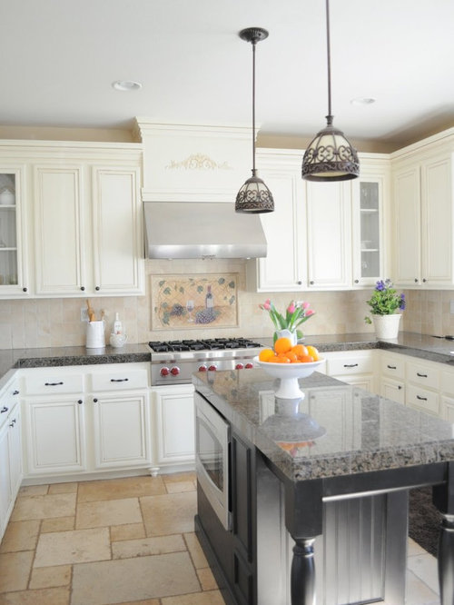 Inspiration for a timeless kitchen remodel in San Diego with white  cabinets, beige backsplash and