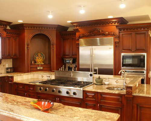 steel appliances, raisedpanel cabinets and dark wood cabinets