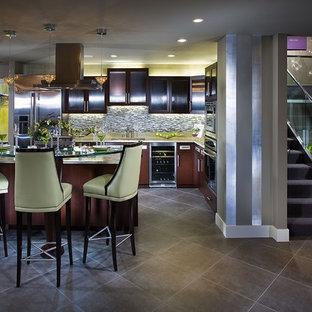 На фото: параллельные кухни в современном стиле с стеклянными фасадами, темными деревянными фасадами, стеклянной столешницей, техникой из нержавеющей стали, обеденным столом, накладной раковиной, серым фартуком, фартуком из плитки мозаики, полом из керамической плитки, островом, коричневым полом и коричневой столешницей