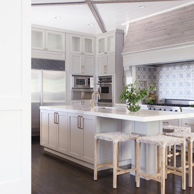 Example of a large transitional u-shaped dark wood floor and brown floor kitchen design in San Diego with an undermount sink, shaker cabinets, gray cabinets, multicolored backsplash, stainless steel appliances, an island and white countertops