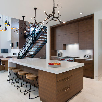 Trendy open concept kitchen photo in Vancouver with flat-panel cabinets, medium tone wood cabinets and stainless steel appliances