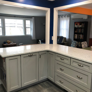 Inspiration for a mid-sized modern l-shaped eat-in kitchen in Boston with an undermount sink, shaker cabinets, grey cabinets, recycled glass benchtops, white splashback, ceramic splashback, stainless steel appliances, porcelain floors, grey floor and white benchtop.