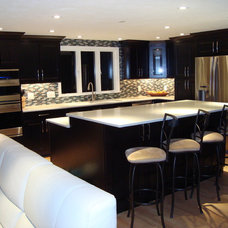 Traditional Kitchen by One Source Construction, LLC.