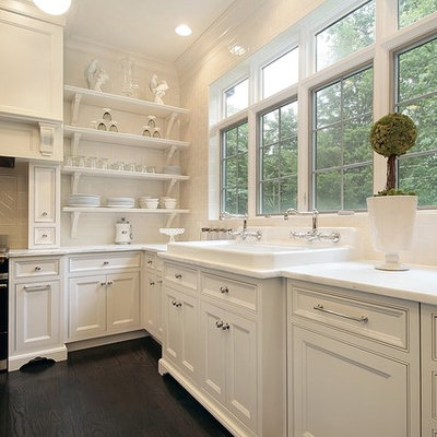 Eat-in kitchen - traditional eat-in kitchen idea in Chicago with a drop-in sink, white cabinets, marble countertops, white backsplash, subway tile backsplash and beaded inset cabinets