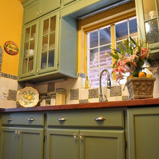 Mediterranean Kitchen by MCCALEB CONSTRUCTION INC