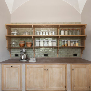 Inspiration for a medium sized traditional galley kitchen pantry in London with recessed-panel cabinets, distressed cabinets, green splashback, porcelain splashback, limestone flooring and no island.