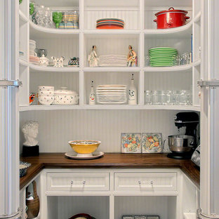 Photo of a traditional u-shaped kitchen pantry in Chicago with open cabinets, white cabinets and wood benchtops.