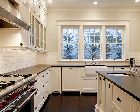 black countertop and white cabinets | houzz